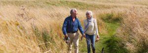 Header - Senior Products Walking Through a Field